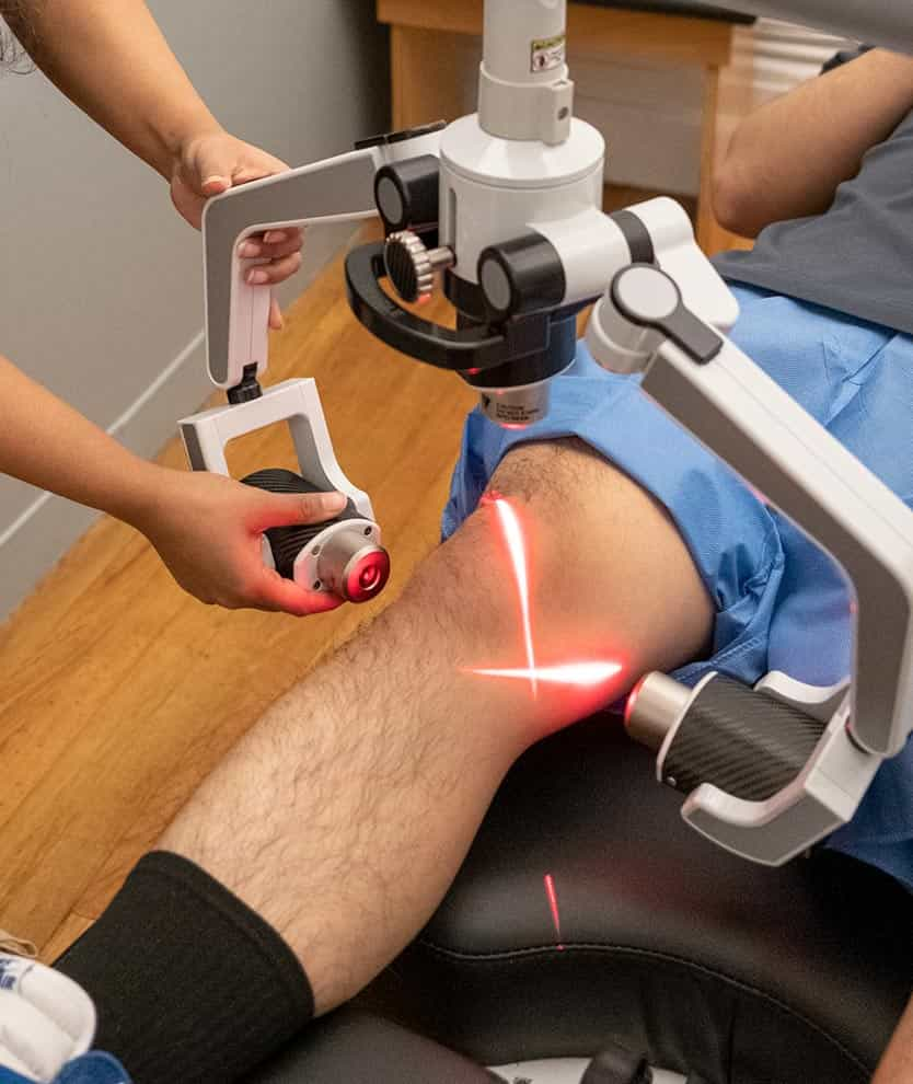 chiropractic treatment for knee pain featuring low level laser therapy