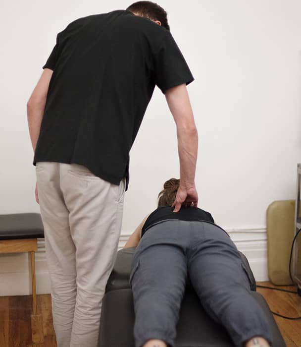 chiropractor checking patient for symptoms and signs of sciatica