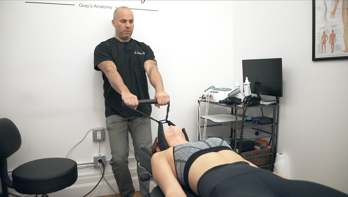 dr steven shoshany using the y strap adjustment on patient in nyc